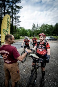 Ronny from Odyssey Adventure Racing greets Paul Morris at the finish line of the Wild, Wonderful